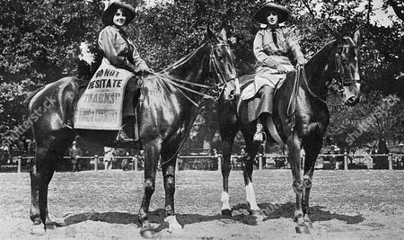 Stock Picture of Irish Sisters Miss Winifred and Ivy Mulroney Riding Together in Hyde Park London to Recruit Men For Lord Kitchener's Army in September 1914 the Banner On One Horse Reads 'Do not Hesitate - to Arms - For King & Country ' 1914