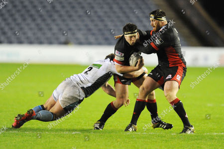 Alasdair Dickinson - Edinburgh prop runs into team mate Simon Berghan as he is tackled by Fraser Brown (2).