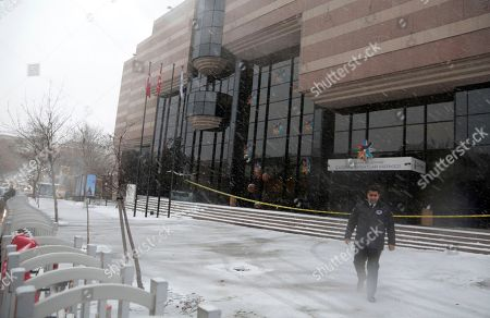 A security guard walks outside the Contemporary Arts Center in Ankara, Turkey, . The center is closed by police four days after a Turkish police officer identified as Mevlut Mert Altintas fatally shot Russian Ambassador to Turkey Andrei Karlov at the building during the opening of a photo exhibition