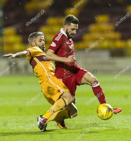 Graeme Shinnie of Aberdeen tackled by Keith Lasley of Motherwell during the SPFL Ladbrokes Premiership match between Motherwell & Aberdeen on 23rd December