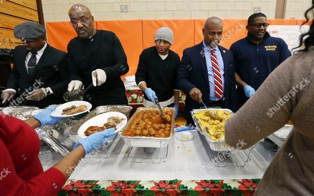 """Delroy Lindo, Ras Baraka Actor Delroy Lindo, second left, joined Newark Mayor Ras Baraka, second right, as they helped serve food at a Newark's Weequahic High School high school during an event to feed residents as part of a program to bring holiday cheer, in Newark, N.J. The London-born Lindo's lengthy film career includes roles in movies such as """"Crooklyn,"""" """"Malcolm X"""" and the TV series """"Blood and Oil"""" and """"The Chicago Code"""