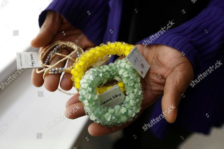 Stock Picture of Barbara Murray displays some of the jewelry for sale at a kiosk at Newark Liberty International Airport in Newark, N.J. The kiosk, The store is part of a program for women recently released from jail or currently in the criminal justice system. They get job skills, some income and, perhaps most important, self-confidence