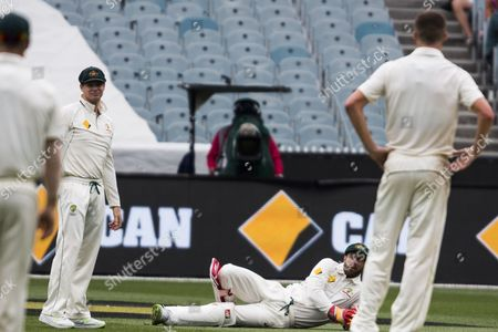 Wicketkeeper Matthew Wade on the round is asked by bowler Jackson Bird if they should refer an LBW during day 2 of the 2nd test between Australia Vs Pakistan