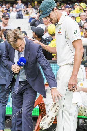 Cricket commentator Mark Nicholas returns after being his hospital with stomach problems looks at Mitchell Starc  bowling shoes during day 3 of the 2nd test between Australia Vs Pakistan