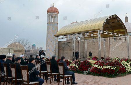 Stock Photo of Kyrgyzstan's President Almazbek Atambayev  and Uzbek President Shavkat Mirziyoyev attend a prayer service at the tomb of recently deceased Uzkebistan President Islam Karimov at the historical cemetery of Shakhi-Zinda in Samarkand, Uzbekistan, 24 December 2016. Atambayev is on an official working visit to Uzbekistan.