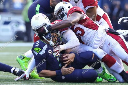Arizona Cardinals linebacker Markus Golden (44) and Arizona Cardinals linebacker Chandler Jones (55) come together to sack Seattle Seahawks quarterback Russell Wilson (3) during a game between the Arizona Cardinals and Seattle Seahawks at CenturyLink Field in Seattle, WA on , 2016