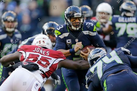 Russell Wilson, Chandler Jones Arizona Cardinals' Chandler Jones (55) joins in as Seattle Seahawks quarterback Russell Wilson is sacked in the first half of an NFL football game, in Seattle
