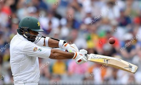 Pakistan's Sohail Khan hits a cut shot against Australia on the third day of their second cricket test match in Melbourne, Australia