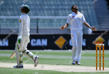 Pakistan's Sohail Khan, right, looks to the sky after dismissing Australia's Peter Handscomb, left, on the fourth day of their second cricket test in Melbourne, Australia