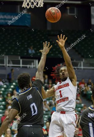 Paris Lee, Junior Etou Illinois State guard Paris Lee (1) shoots the basketball as Tulsa forward Junior Etou (0) attempts to block Lee's shot during the second half of an NCAA college basketball game at the Diamond Head Classic, in Honolulu. Illinois State beat Tulsa 68-56