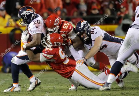 Stock Image of Henry Krieger-Coble, Justin Forsett, Chris Jones, Dee Ford Denver Broncos running back Justin Forsett (20) is tackled by Kansas City Chiefs defensive lineman Chris Jones (95) and linebacker Dee Ford (55), with Denver Broncos tight end Henry Krieger-Coble (84) joining in during the first half of an NFL football game in Kansas City, Mo