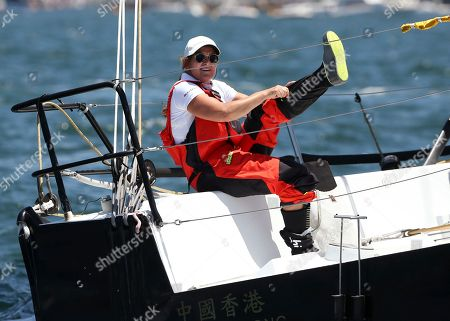 Stock Photo of Food stylist and author Donna Hay pulls on her boot while sailing onboard Beau Geste just before the start of the Sydney Hobart yacht race in Sydney, Australia, . The 88 yachts leave from Sydney Harbour in the annual 628-nautical mile race to Australia's island state of Tasmania