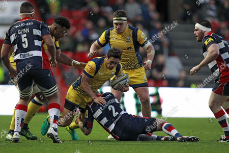 Jackson Willison of Worcester Warriors (centre) is tackled by Rob Hawkins of Bristol Rugby