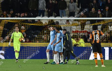 John Stones of Manchester City goes off injured as Aleksander Kolarov of Manchester City comes on during the Premier League match between Hull City and Manchester City played at The KCOM Stadium,  Hull on Monday the 26th of December 2016