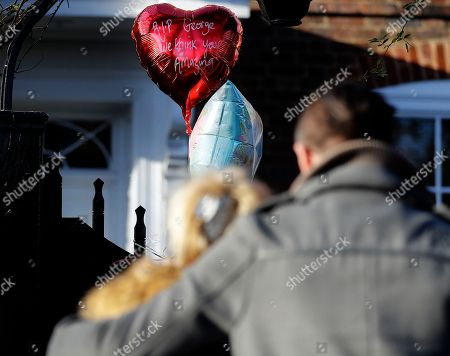 Fans mourn outside the home of British musician George Michael in London, . George Michael, who rocketed to stardom with WHAM! and went on to enjoy a long and celebrated solo career lined with controversies, has died, his publicist said Sunday. He was 53