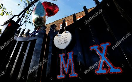 Fans have decorated the entrance gate outside the home of British musician George Michael in London, . George Michael, who rocketed to stardom with WHAM! and went on to enjoy a long and celebrated solo career lined with controversies, has died, his publicist said Sunday. He was 53