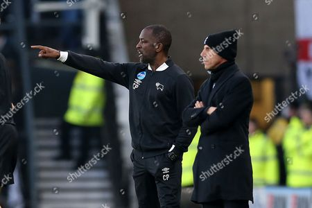 Chris Powell, Derby County assistant manager, on the touchline with Gianfranco Zola