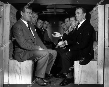 """'The League of Gentlemen'   Film  The Members of the """"League"""" Sit in a Police Van Together. Left to Right: John Hyde (Jack Hawkins),  Mycroft (Roger Livesey), Porthill (Bryan Forbes), Rutland Smith (Terence Alexander),  Weaver (Norman Bird, Stevens (Kieron Morre), Edward Lexy (Richard Attenborough) and Race (Nigel Patrick) Who Has Handcuffs on"""