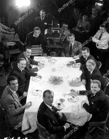 """'The League of Gentlemen'   Film  The """"League"""" Sit Down at Their First Meeting Together with John Hyde (Jack Hawkins) Top Right.  Porthill (Bryan Forbes), Mycroft (Roger Livesey), Edward Lexy (Richard Attenborough), Race (Nigel Patrick), Stevens (Kieron Morre), Weaver (Norman Bird and Rutland Smith (Terence Alexander)."""