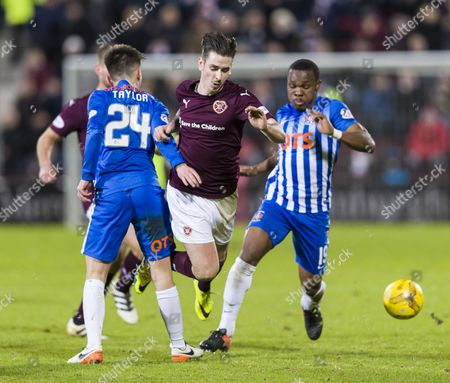 Jamie Walker of Heart of Midlothian tackled by Greg Taylor of Kilmarnock during the SPFL Premiership match between Heart of Midlothian & Kilmarnock played at Tynecastle, Edinburgh on 27th December