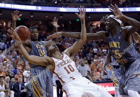Eric Davis Jr., Jimmy Hall Texas guard Eric Davis Jr. (10) is blocked by Kent State forward Jimmy Hall (35) as he tries to score during the final seconds of an NCAA college basketball game, in Austin, Texas. Kent State won 63-58