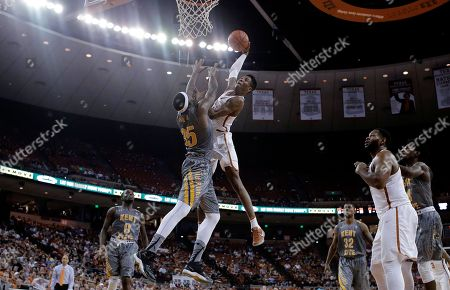 Kerwin Roach Jr., Jimmy Hall Texas guard Kerwin Roach Jr. (12) drives to the basket against Kent State forward Jimmy Hall (35) during the second half of an NCAA college basketball game, in Austin. Kent State won 63-58