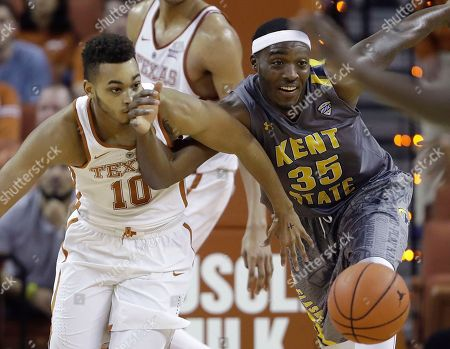 Eric Davis Jr., Jimmy Hall Texas guard Eric Davis Jr. (10) and Kent State forward Jimmy Hall (35) scramble for a loose ball during the second half of an NCAA college basketball game, in Austin, Texas. Kent State won 63-58