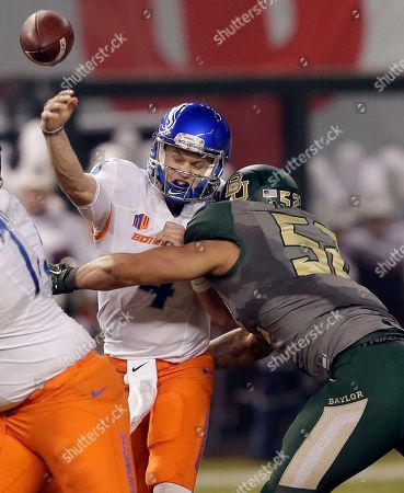 Boise State quarterback Brett Rypien (4) is hit by Baylor defensive end Greg Roberts (52) as he throws during the first half of the Cactus Bowl NCAA college football game, in Phoenix