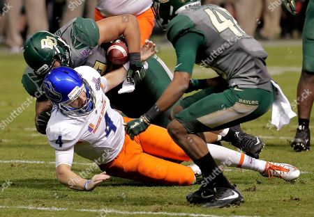 Baylor defensive end Greg Roberts strips the ball away from Boise State quarterback Brett Rypien (4) for a fumble during the second half of the Cactus Bowl NCAA college football game, in Phoenix. Baylor recovered the ball