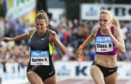 Belgian Olivia Borlee (l) is on Her Way to Win the Women's 200m Race Ahead of Her Compatriot Hanne Claes (r) at the Kbc Night Athletics Meeting in Heusden-zolder Belgium 07 July 2012 Belgium Heusden-zolder