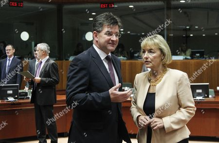 Slovakian Foreign Minister Mikulas Dzurinda (l) Talks with Croatian Foreign Minister Vesna Pusic (r) at the Start of a Eu Foreign Affairs Council at the European Council Headquarters in Brussels Belgium 23 July 2012 During This Session Items Such As Southern Neighbourhood Including Syria and Libya Sudan and Democratic Republic of Congo Will Be Discussed Belgium Brussels