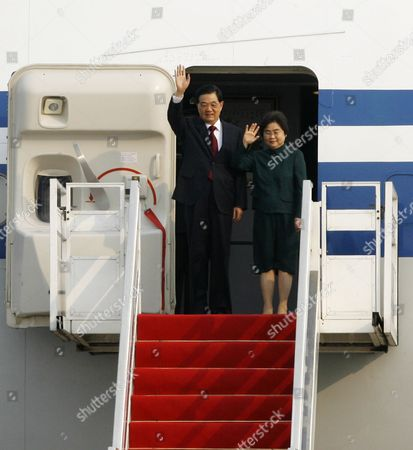 Chinese President Hu Jintao (l) and His Wife Liu Yongqing (r) Greet Well-wishers Upon Their Arrival at Phnom Penh International Airport Cambodia 30 March 2012 Hu Jintao is on an Official Visit to Cambodia During Which the President Will Meet with Cambodian King Norodom Sihamoni President of the Senate Chea Sim President of the National Assembly Heng Samrin Including Prime Minister Hun Sen Cambodia Phnom Penh