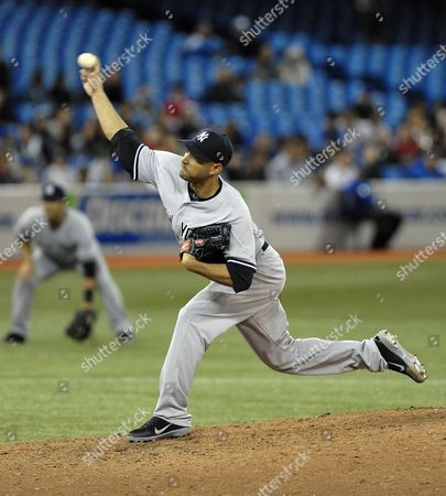 New York Yankees Pitcher Cory Wade Throws in the Seventh of Their Mlb American League East Baseball Game Against the Toronto Blue Jays in Toronto Canada on 17 May 2012 Canada Toronto
