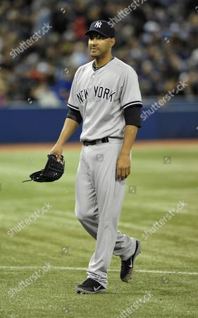 New York Yankees Pitcher Cory Wade Walks Off the Field at the End of the Seventh Inning Against the Toronto Blue Jays in Their Mlb American League East Baseball Game in Toronto Canada on 17 May 2012 Canada Toronto