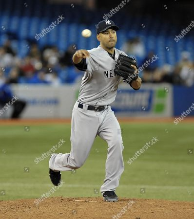 New York Yankees Pitcher Cory Wade Throws to First Base For an Attempted Pick-off in the Seventh Inning of Their Mlb American League East Baseball Game Against the Toronto Blue Jays in Toronto Canada on 17 May 2012 Canada Toronto
