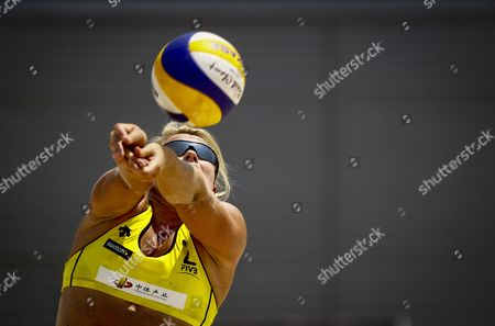 Great Britain's Denise Johns Hits a Return During a Match Between Great Britain's Pair Johns/boulton Against Canadian Pair Martin/lessard For a Women's First Round Match at the Swatch Fivb World Tour Beijing Grand Slam in Beijing China 08 May 2012 China Beijing