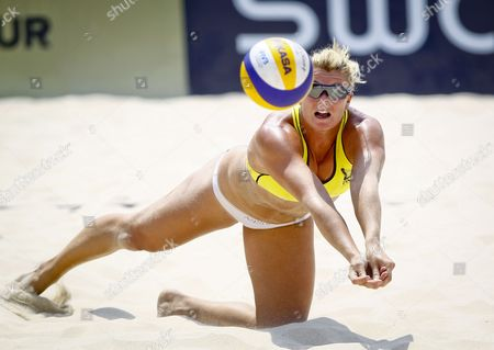 Great Britain's Denise Johns Dives to Hit a Return During a Match Between Great Britain's Pair Johns/boulton Against Canadian Pair Martin/lessard For a Women's First Round Match at the Swatch Fivb World Tour Beijing Grand Slam in Beijing China 08 May 2012 China Beijing
