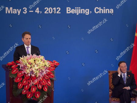 Us Treasury Secretary Tim Geithner (l) Makes an Address As Chinese Vice Premier Wang Qishan (r) Listens at the Opening Ceremony of the Fourth Round of Us-china Strategic and Economic Dialog at the Diaoyutai State Guesthouse in Beijing China 03 May 2012 the Talks Are Headed by Senior Members of Government From Both Sides and Will Wrangle with a Number of Economic and Trade Issues That Are Having Global Repercussions China Beijing
