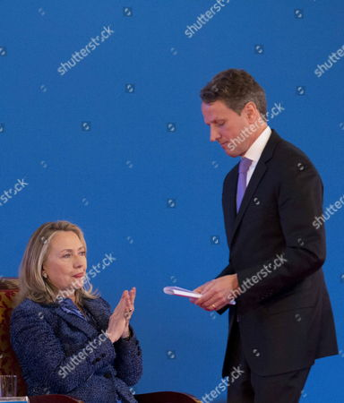 Us Secretary of State Hillary Clinton (l) Applauds After the Speech Delivered by Us Treasury Secretary Tim Geithner at the Opening Ceremony of the Fourth Round of the Us-china Strategic and Economic Dialog at the Diaoyutai State Guesthouse in Beijing China 03 May 2012 the Talks Are Headed by Senior Members of Government From Both Sides and Will Wrangle with a Number of Economic and Trade Issues That Are Having Global Repercussions China Beijing