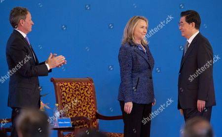 Chinese President Hu Jintao (r) Speaks with Us Secretary of State Hillary Clinton (c) As Us Treasury Secretary Tim Geithner (l) Applauds at the Opening Ceremony of the Fourth Round of Us-china Strategic and Economic Dialog at the Diaoyutai State Guesthouse in Beijing China 03 May 2012 the Talks Are Headed by Senior Members of Government From Both Sides and Will Wrangle with a Number of Economic and Trade Issues That Are Having Global Repercussions China Beijing