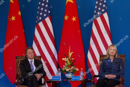 Us Secretary of State Hillary Clinton (r) and Us Treasury Secretary Tim Geithner (l) Listen As Chinese Vice Premier Wang Qishan Makes a Speech at the Opening Ceremony of the Fourth Round of the Us-china Strategic and Economic Dialog at the Diaoyutai State Guesthouse in Beijing China 03 May 2012 the Talks Are Headed by Senior Members of Government From Both Sides and Will Wrangle with a Number of Economic and Trade Issues That Are Having Global Repercussions China Beijing