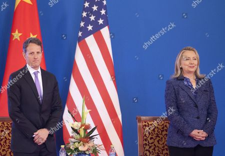 Us Secretary of State Hillary Clinton (r) and Us Treasury Secretary Tim Geithner Listen to the Chinese National Anthem at the Opening Ceremony of the Fourth Round of Us-china Strategic and Economic Dialog at the Diaoyutai State Guesthouse in Beijing China 03 May 2012 the Talks Are Headed by Senior Members of Government From Both Sides and Will Wrangle with a Number of Economic and Trade Issues That Are Having Global Repercussions China Beijing