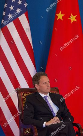 Us Treasury Secretary Tim Geithner Listens As Us Secretary of State Hillary Clinton (not Pictured) Makes an Address at the Opening Ceremony of the 4th Round of Us-china Strategic and Economic Dialog at the Diaoyutai State Guesthouse in Beijing China 03 May 2012 the Talks Are Headed by Senior Members of Government From Both Sides and Will Wrangle with a Number of Economic and Trade Issues That Are Having Global Repercussions China Beijing