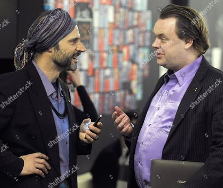 Stock Picture of Swedish Founder of the First Pirate Party Rick Falkvinge (r) Chats with a Delegate During the Pirate Parties International Conference (ppi) in Prague Czech Republic 15 April 2012 Pirate Parties From 20 Countries Meet on 14 and 15 April 2012 in Prague During This Conference the General Assembly - the Highest Body of the Ppi - Will Decide Upon the Admittance of New Members to the Ppi Elect a New Board and Discuss and Vote on Amendments to the Ppi Statutes Czech Republic Prague