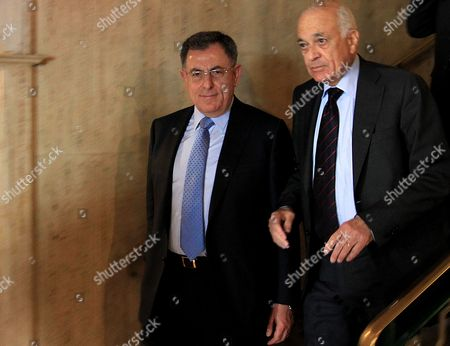 Lebanese Former Prime Minister and Head of the Future Parliamentary Bloc Fouad Siniora (l) Walks with Arab League Secretary General Nabil Alaraby (r) As He Leaves Following Their Meeting at the League's Headquarters in Cairo Egypt 29 April 2012 Egypt Cairo