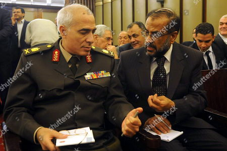 General Mamdouh Shahin (l) Member of the Ruling Egyptian Supreme Council Speaks with an Unidentified Member of Egypt's Constituent Assembly During the First Meeting of the Assembly in Cairo Egypt 28 March 2012 Media Reports Said People's Assembly Speaker and Leading Muslim Brotherhood Member Saad Al-katatni was Elected Head of the Assembly During the First Session the Formation of the 100-member Panel Assigned with Drafting New Constitution Sparked Anger Among Several Liberal Egyptian Politicians who Rejected the Islamist Domination of the Assembly Egypt Cairo