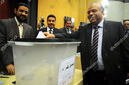 Egyptian Parliament Speaker Saad Al-katatni (r) Casts His Vote During Elections to Choose Members of Constituent Assembly Tasked with Drafting the New Constitution in Cairo Egypt 24 March 2012 Media Reports Stated That a Joint Parliament Session Convened on 24 March to Elect the 100-member Committee That Will Draft Egypt's Post-revolution Constitution the Committee Will Be Made Up of 50 Members From the Parliament While the Remaining 50 Will Be Legal Experts Academics Intellectuals Unions' Members and Religious Scholars Egypt Cairo