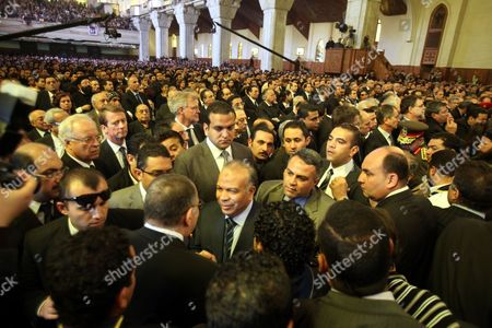 Egyptian Parliament Speaker Saad Al-katatni (c) Attends the Funeral of Pope Shenouda Iii the Head of Egypt's Coptic Orthodox Church at the Abassiya Cathedral in Cairo Egypt 20 March 2012 Thousands of People Packed the Cathedral For the Funeral of Pope Shenouda Iii who Died on 17 March at the Age of 88 Several Bishops Are to Escort Shenouda's Body by Military Plane to St Bishoy Monastery in the North of the Country For the Burial Egypt Cairo