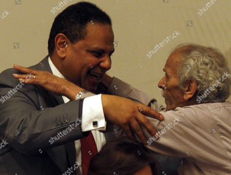 Egyptian Author Alaa Al-aswany (l) Hugs Poet Ahmed Foued Negm Also Known As Al-faggomi After the Poet Read Some of His Creations at the End of a Press Conference Announcing a New Party Held at the Egyptian Press Syndicate in Cairo Egypt 28 April 2012 Elbaradei and a Group of Pro-revolution Personalities Announced Officially on 28 April the Launch of the New 'Adoustour' Political Party Aiming at Gathering the Egyptian Revolutionaries Egypt Cairo