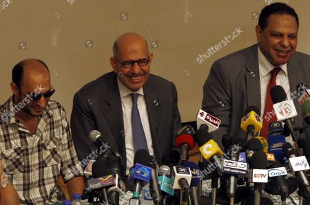 Egyptian Nobel Peace Prize Winner and Former Head of the International Atomic Energy Agency Mohamed Elbaradei (c) Revolutionary Youth Ahmed Harara (l) and Novelist Alaa Al-aswany (r) Smile As They Address a Press Conference Announcing the Launch of a New Party at the Egyptian Press Syndicate in Cairo Egypt 28 April 2012 Elbaradei and a Group of Pro-revolution Personalities Announced Officially on 28 April the Launch of the New 'Adoustour' Political Party Aiming at Gathering the Egyptian Revolutionaries Egypt Cairo